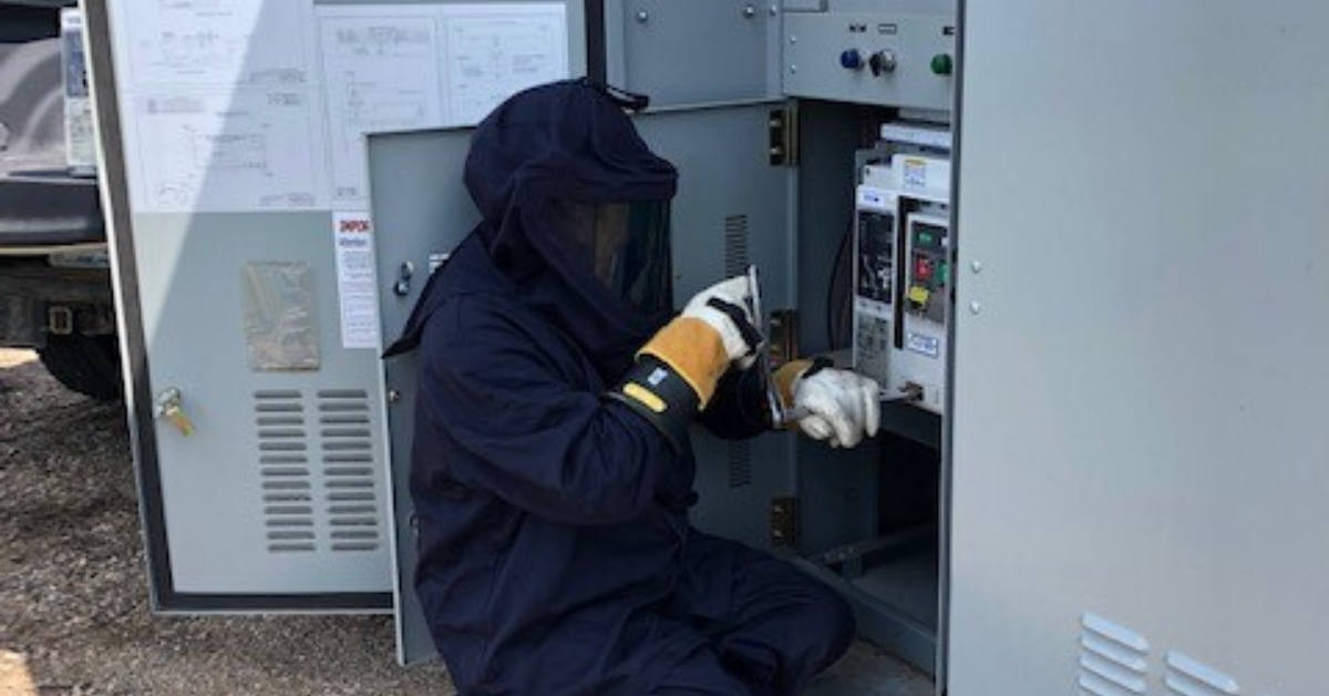 Image of a man working on a panel